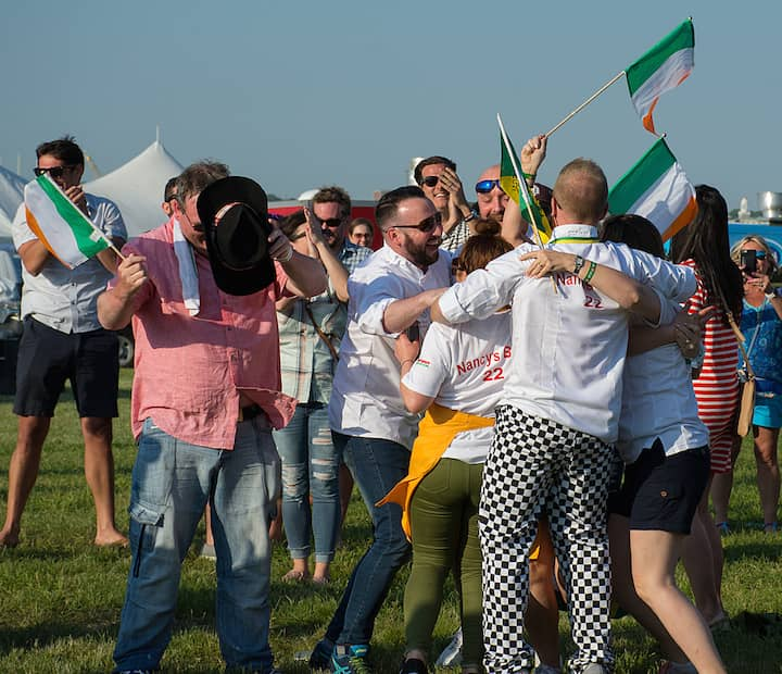 [CREDIT: Mary Carlos] A wildly excited group from Nancy's Barn, Ballyliffin Ireland celebrate their first place win for best seafood during the Great Chowder Cook-Off at Fort Adams, Newport.