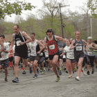 Norm Bouthillier and Katie Moulton, first place finishers, get a quick start at the the Rocky Point 5K on May 10, 2014.