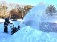 Brandon Fratus clears his driveway on Bunker Street Wednesday afternoon. He'd already spent the previous day digging out.