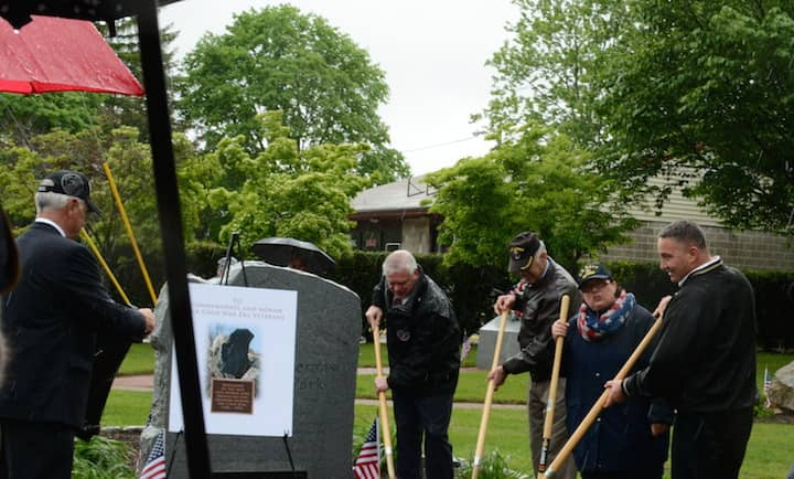 [CREDIT: Rob Borkowski]  A ceremonial ground breaking for the new Cold War monument during 2017 Memorial Day ceremonies in front of Warwick Veterans Jr. High.