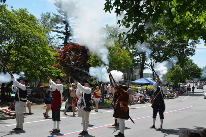[CREDIT: Rob Borkowski] The Gloucester Light Infantry Military Militia fire their muskets at the start of the Gaspee Days Parade June 9, 2018.