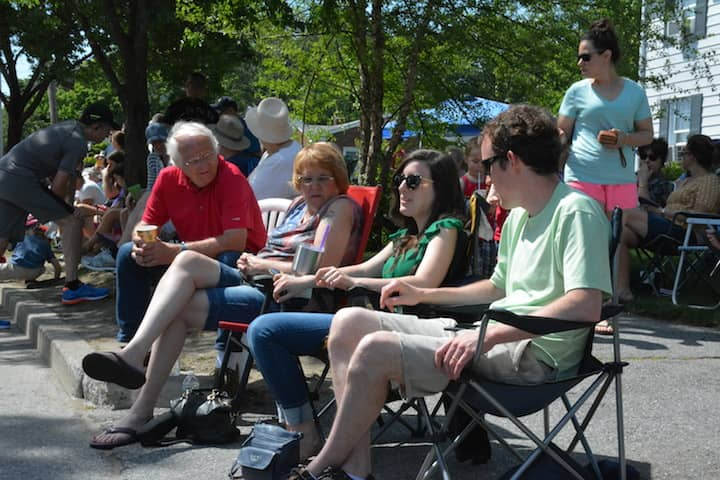 [CREDIT: Rob Borkowski] From left, Ron Cameron, Robin Greene, Becca Sanders and Nate Sanders wait on Narragansett Parkway in before Gaspee Days events Saturday, June 9, 2018.