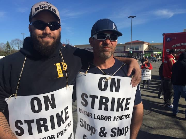 [CREDIT: Rob Borkowski] From left, Richard Miller, steward for Local UFCW 328, and John Ardente, a grocery clerk, at the 2470 Warwick Ave. Stop & Shop strike Tuesday.