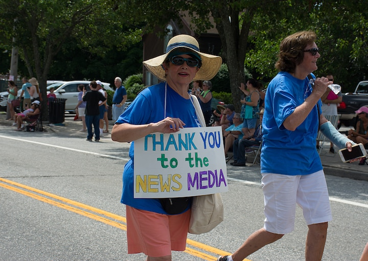 [CREDIT: Mary Carlos] Organizers of the Conimicut Apollo 11 parade carried signs thanking sponsors and contributors to the parade July 20, 2019.