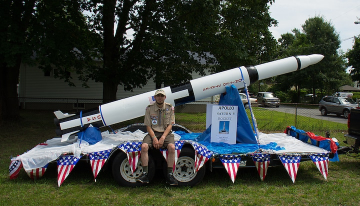 [CREDIT: Mary Carlos] Eagle Scout William Conklin poses with the Troop 1 Conimicut model of the Saturn V rocket after the Conimicut Apollo 11 parade July 20, 2019.