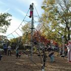 [CREDIT: Rob Borkowski] Children climb higher than was previously possible atop new playground equipment at the Salter Grove Park ribbon cutting Oct. 26.