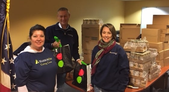 [CREDIT: BGCW] HarborOne volunteers played an important role by packing more than 200 bags of sides for each family aided by Stop&Shop donated turkeys.Pictured from left to right are HarborOne employees Maria Boyle, Steve Gibbons and Kathy Goulding.