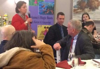 [CREDIT: Rob Borkowski] Sue Babin addresses a crowd of about 50 at Chelo's on Post Road Jan. 15 during the RIDDC's quarterly meeting.