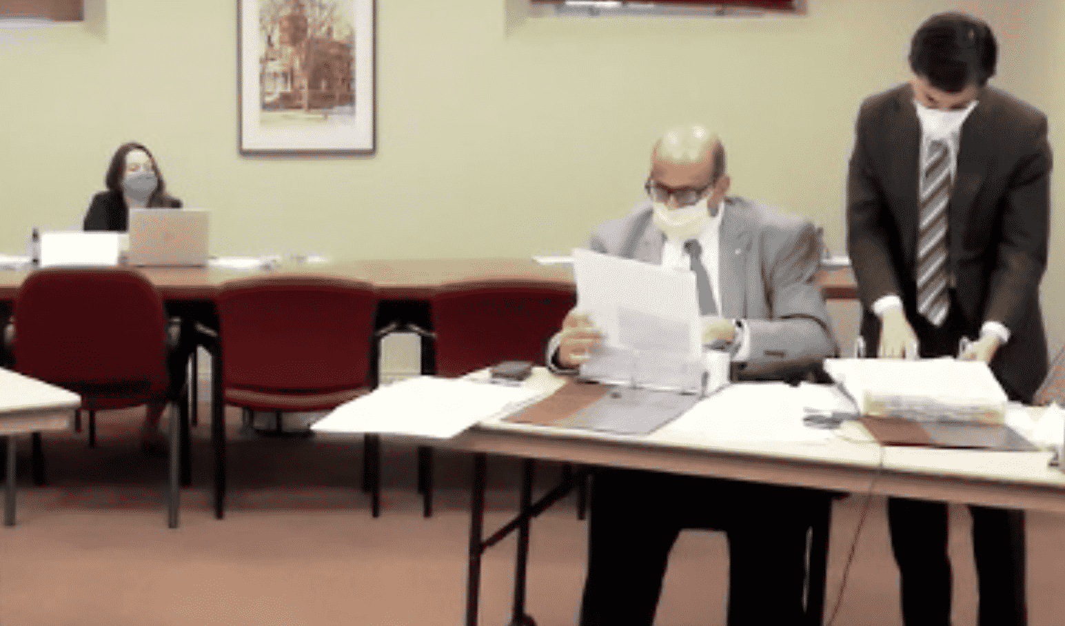 [CREDIT: City of Warwick] From left, Michael D'Amico, finance consultant, and Mayor Joseph J. Solomon search the budget in search of the answer to a budget question May 27 during budget hearings. The night was noteworthy for several questions the Mayor did not answer.